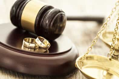 Gavel, wedding rings, and the scales of justice - all representing a status only divorce